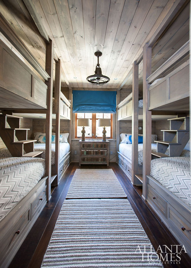 Rustic Cabin Bunk Room. Rustic cabin bunk room with 8 bunk beds, rustic shiplap walls and muted greywash shiplap ceiling #RusticCabinBunkRoom #RusticBunkRoom #BunkRoom #RusticBunkRoom #8bunkbeds #bunkbeds #rusticshiplap #shiplap #shiplapwalls #washedshiplap #shiplapceiling #shiplapwalls Meridy King Interiors via Atlanta Homes & Lifestyles