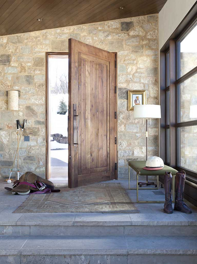 Rustic Farmhouse Foyer with stone wall and rustic stone flooring, large windows and wood paneling ceiling. #Foyer #farmhouse #rusticinteriors #rusticfarmhouse #rusticfoyer #RusticFarmhouseFoyer #stonewall #rusticstone #rusticflooring #largewindows #woodpaneling #wood Andrea Lawrence Wood Interior Designceiling