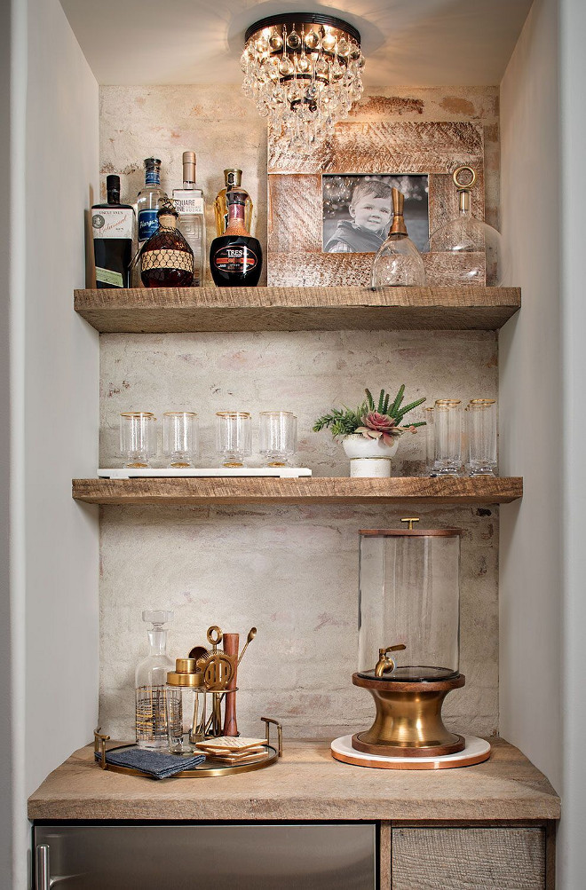 Rustic Farmhouse Wet Bar Butlers Pantry. Rustic Farmhouse Wet Bar Butlers Pantry with white brick wall and reclaimed wood shelves. Farmhouse wet bar with white brick wall and reclaimed wood shelves. The accent ​brick wall features a whitewash over the brick and it's done with grout washing not paint. Rustic Farmhouse Wet Bar Butlers Pantry #RusticFarmhouseWetBar #RusticFarmhouseButlersPantry #RusticWetbar #Farmhousebutlerspantry Tracy Lynn Studio
