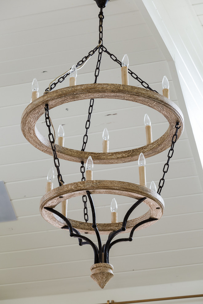 Two-tiered whitewashed wood chandelier. Shades of Light Countryside Elegance Tiered Chandelier A 2-tier chandelier of rusted iron and artistically distressed wood, this simple yet elegant design brings stately countryside elegance into the room. #twotieredchandelier #whitewashedwoodchandelier #Shadesoflight #CountrysideEleganceTieredChandelier