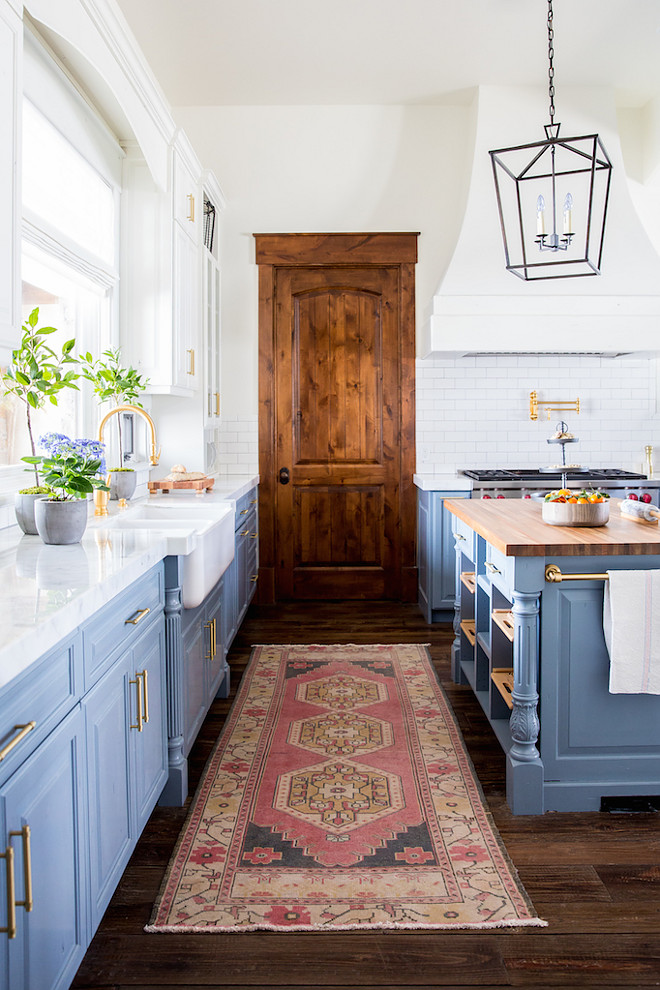 Vintage kilim runner. Kitchen runner. A vintage kilim runner adds a bit of bright color to the space. This is a favorite kitchen layer of mine that adds interest and warmth. #kilimrunner #kitchenkilimrunner #kitchenrunner #Vintagekilimrunner Becki Owens Becki Owens & Jamie Bellessa