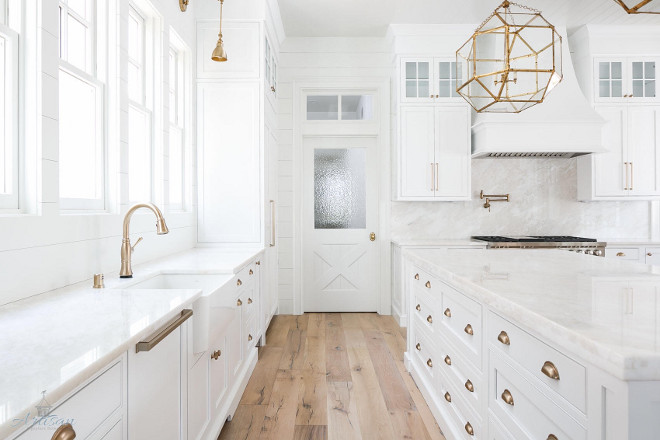 White Farmhouse Kitchen. White Farmhouse Kitchen. This White Farmhouse Kitchen combines classic elements like the white marble countertop and backsplash with farmhouse trends such as shiplap paneling, cross hatch pantry door, tongue and groove ceiling and white oak floors #farmhousekitchen #farmhousekitchens #whitefarmhousekicthen #kitchen #shiplap #tongueandgroove whiteoak #whiteoakfloor #flooring #hardwoodflooring Artisan Signature Homes. Grey House Design