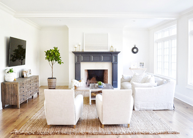 White Living Room with Dark Painted Fireplace Mantel. White Living Room with Dark Painted Fireplace Mantel. White Living Room with Dark Painted Fireplace Mantel #WhiteLivingRoom #DarkPaintedfireplace #FireplaceMantel Beautiful Homes of Instagram @HomeSweetHillcrest