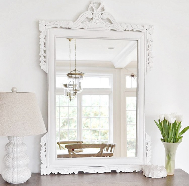 White Mirror in Dining Room. Wood mirror painted in white. The painted white wood mirror is from Overstock and the lamp is from HomeGoods.Dining Room Mirror #mirror #paintedmirror #whitemirror Beautiful Homes of Instagram @HomeSweetHillcrest