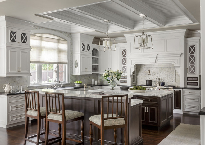 White kitchen with dark stained kitchen island, Stunning white kitchen with walnut stained kitchen islands, Classic White kitchen with dark stained kitchen island, White kitchen with dark stained kitchen island, White kitchen with dark stained kitchen island #Whitekitchen #classicwhitekitchen #kitchen #whitekitchens #timelesswhitekitchen #dark stainedkitchenisland Spectrum Interior Design, Inc