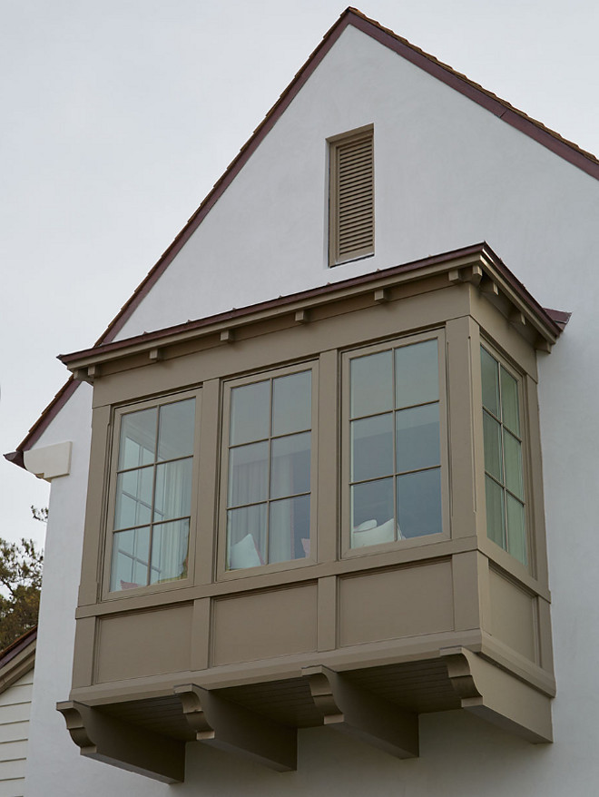 Window Trim and Corbels. Beautiful window trim and corbels, painted in a deep mushroom paint color, contrasts with the off-white exterior. Exterior Window Trim and Corbels. Window Trim and Corbels #WindowTrim #Corbels #Windowcorbel Andrew Howard Interior Design