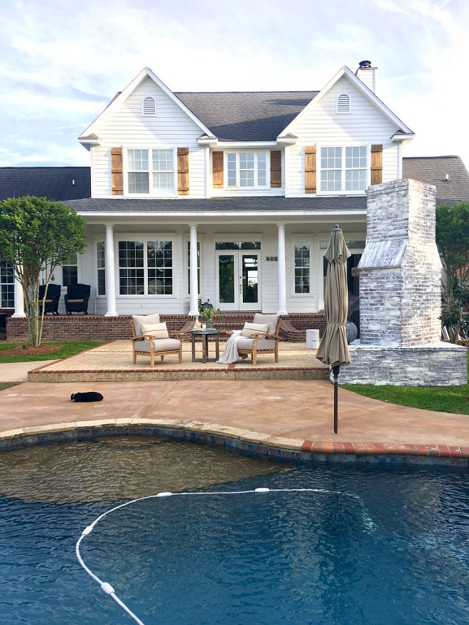 Back View of Traditional Farmhouse with pool and outdoor brick fireplace. The exterior paint color is Benjamin Moore White. #houseBackView #TraditionalFarmhouse #pool #outdoorbrickfireplace Beautiful Homes of Instagram @cindimc.ivoryhome