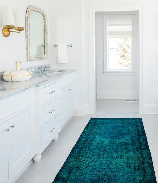 Bathroom Runner. Teal bathroom runner is by Fay + Belle. A gorgeous teal runner brings some color to this white bathroom. The master bathroom tile is Embarcadero Porcelain from Tile X Design. Teal bathroom runner #Bathroomrunner #Tealrunner #tealbathroomrunner #runner Martha O'Hara Interiors