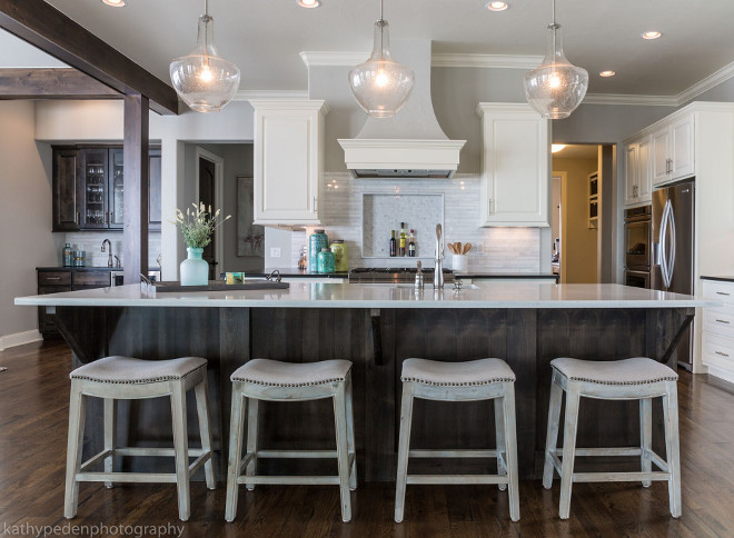 Benjamin Moore Revere Pewter Kitchen. This kitchen is timeless with white cabinetry, dark quartz countertops and marble backsplash. Wall paint color is Revere Pewter by Benjamin Moore #BenjaminMooreReverePewter #Kitchen #ReverePewterbyBenjaminMoore Restyle Design, LLC.
