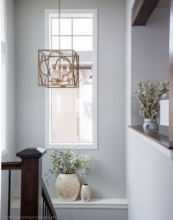 Benjamin Moore Revere Pewter. Wall color on the whole main floor is Benjamin Moore Revere Pewter. Lighting is Currey and Company Cosette Lantern #BenjaminMooreReverePewter Restyle Design, LLC.
