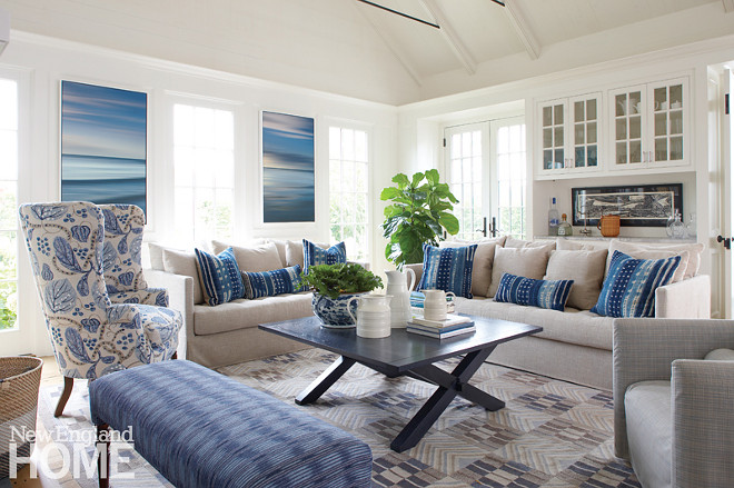 Blue and white living room. Coastal blue and white living room. A seat for everyone was the goal in the living room, where a pair of John Duckworth photographs stands in for views. Coastal blue and white living room #Coastalblueandwhitelivingroom #Coastallivingroom #blueandwhite #livingroom Nancy Serafini