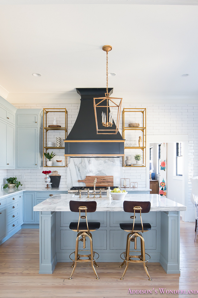 Blue kitchen with white marble countertop. The brass shelves are from Blackstocks. Blue kitchen with white marble countertop. Blue kitchen with white marble countertop. Blue kitchen with white marble countertop. Blue kitchen with white marble countertop. Blue kitchen with white marble countertop #Bluekitchenwithwhitemarblecountertop #Bluekitchen #whitemarblecountertop #whitemarble #countertop Home Bunch's Beautiful Homes of Instagram @addisonswonderland