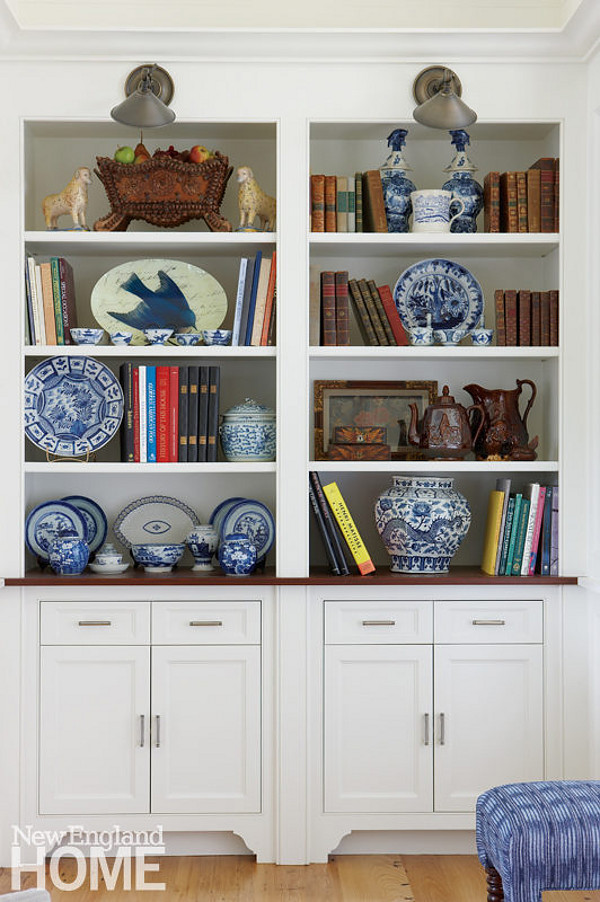 Bookshelf Decorating ideas. The designer displays her favorite antique dishware on the living room's bookshelves. Cabinet paint color is Benjamin Moore OC-17 White Dove. Bookshelf Decorating ideas. Traditional Bookshelf Decorating ideas. Bookshelf Decorating ideas #BookshelfDecoratingideas #BookshelfDecor Nancy Serafini