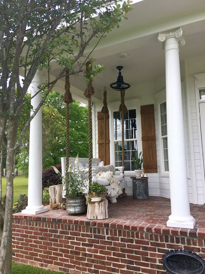 Brick Porch. Traditional Farmhouse with Porch Swing and Brick Porch. Brick Porch. The brick is solid and is made in molds by hand to look like old brick the name is Orleans. Traditional Farmhouse with Porch Swing and Brick Porch #BrickPorch #Brick #porch #TraditionalFarmhouse #TraditionalFarmhouseporch #PorchSwing #Brick #Porch Beautiful Homes of Instagram @cindimc.ivoryhome