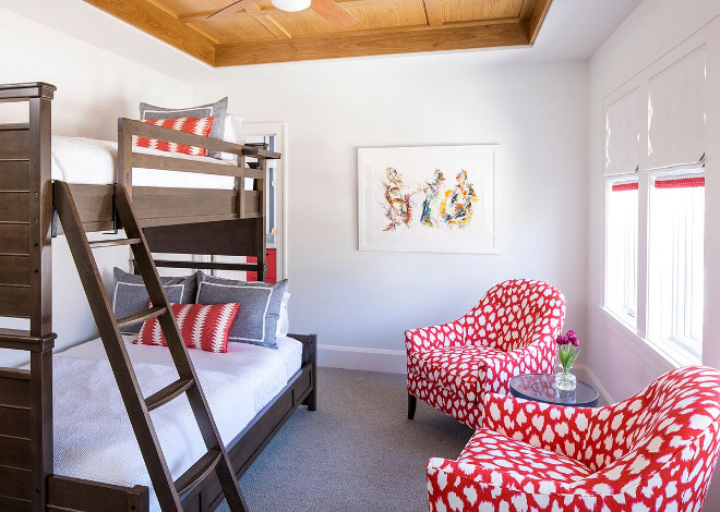 Bunkroom. Kids Bunk room Ideas. This guest bedroom becomes more practical with a store-bought bunk bed. The space also features two custom chairs in Kate Spade fabric. Aren't they beautiful?! Store bought bunk beds bunk room. #Bunkroom #KidsBunkroom #KidsBunkroomIdeas #Storeboughtbunkbed #Storeboughtbunkbeds #bunkroom Martha O'Hara Interiors