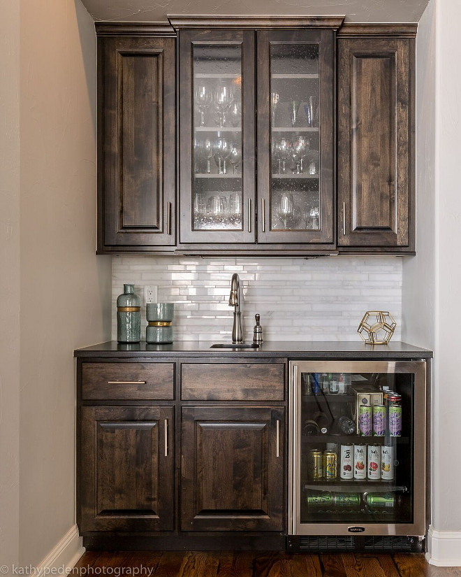 Butlers Pantry cabinet. Dark Stained Butlers Pantry Cabinet Butlers Pantry cabinet. This butler's pantry has an elegant feel with black walnut stained cabinetry, marble backsplash, and stainless hardware. Dark Stained Butlers Pantry Cabinet #ButlersPantry #ButlersPantrycabinet #DarkStainedCabinet #ButlersPantryCabinet Restyle Design, LLC.