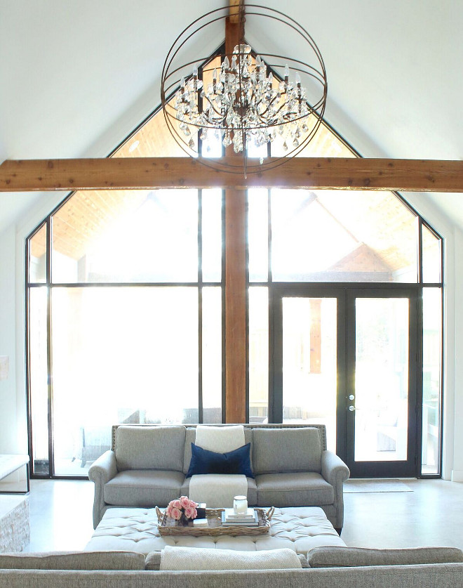 Cathedral Ceiling Window Ideas. Living room with Cathedral Ceiling and Floor to Ceiling Windows. Our living room features a cathedral ceiling, cedar wrapped beams, and a floor to ceiling Windows #CathedralCeiling #CathedralceilingWindow #WindowIdeas #Livingroom #CathedralCeiling #FloortoCeiling #Windows #cedarwrappedbeams #beams Beautiful Homes of Instagram @organizecleandecorate
