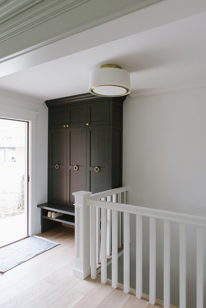 Cheating Heart Benjamin Moore. If your home doesn't come with a mudroom you can make one! the interior designer created a built in with plenty of storage to act as a convenient mudroom near the entrance of the home. The cabinet paint color is Cheating Heart by Benjamin Moore Mudroom cabinet paint color Cheating Heart Benjamin Moore. Cheating Heart Benjamin Moore Cheating Heart Benjamin Moore #CheatingHeartBenjaminMoore