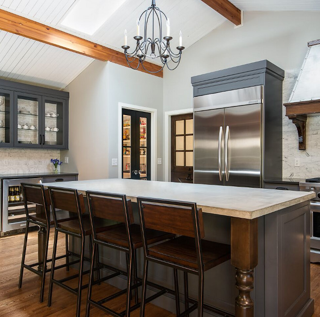 Concrete Countertop. Concrete Kitchen Countertop. Farmhouse kitchen with Concrete Countertop. The kitchen countertop is poured and sealed concrete, no color added. Island with Concrete Countertop #ConcreteCountertop #Concrete #KitchenCountertop #Farmhousekitchen #Islandcountertop reDesign home llc