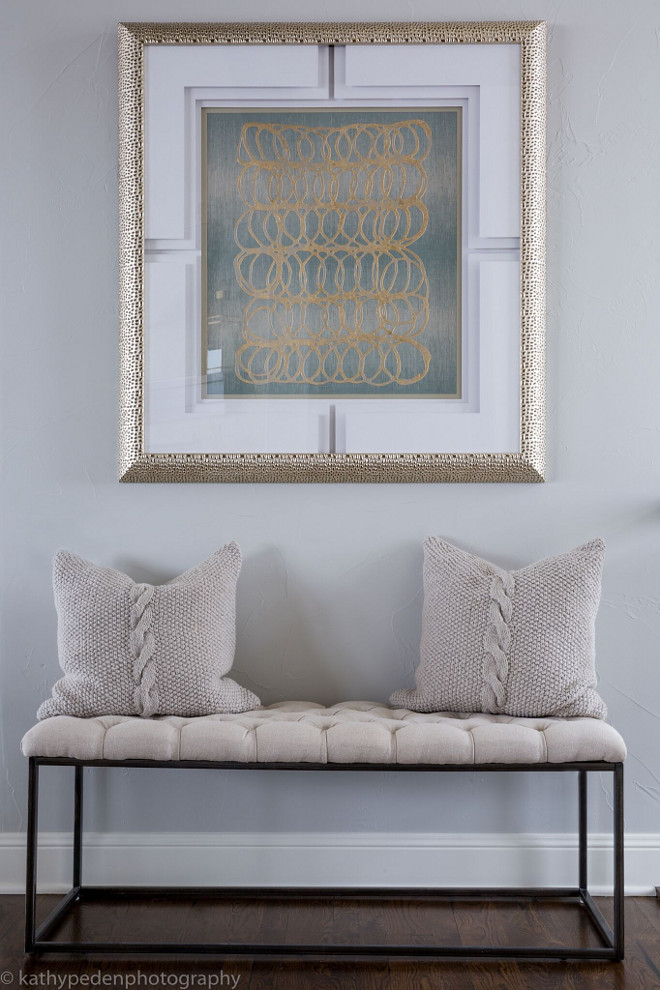 Entry. Entry Decor. Tufted upholstered bench by Classic Home Furnishings and contemporary artwork by Paragon create impact in this entry. Cable knit pillows by Villa Home. #Entry #Entrydecor Restyle Design, LLC.