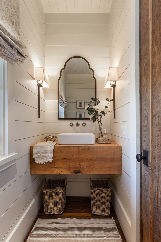 Farmhouse Bathroom with shiplap walls, floating wood slab vanity and Roman shades. Farmhouse Bathroom with shiplap walls, floating wood slab vanity and Roman shades #FarmhouseBathroom #bathroomshiplap #shiplap #floatingwoodslabvanity #floatingvanity #woodvanity #Romanshades Wright Design
