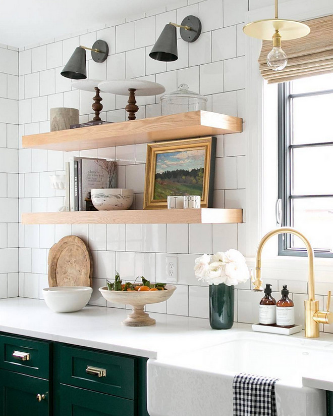 Farmhouse Kitchen Floating Shelves. Modern farmhouse kitchen with chunky floating shelves and white tile backsplash. Farmhouse Kitchen Floating Shelves and white backsplash tile #FarmhouseKitchen #FloatingShelves Studio McGee.