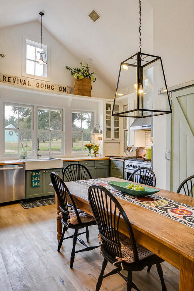 Farmhouse Kitchen. Farmhouse Kitchen Design. Beautiful farmhouse style kitchen with band sawn plank floors, vaulted ceilings and an antique sign. Farmhouse Kitchen. Farmhouse Kitchen Design. Farmhouse Kitchen. Farmhouse Kitchen Design #FarmhouseKitchen #FarmhouseKitchenDesign #FarmhouseKitchens #Farmhouse #KitchenDesign #Farmhouses #bandsawnplankfloor #vaultedceilings #antiquesign #farmhousesigns #vintagesigns Van Wicklen Design