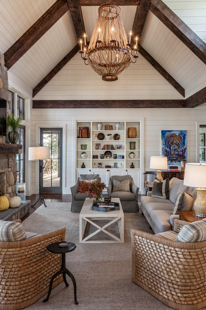 Farmhouse Living room with floor to ceiling shiplap. Farmhouse Living room features floor-to-ceiling shiplap, exposed beams on vaulted ceilings, rope and iron chandelier and a pair of natural fiber chairs. Chandelier is a Luigi Chandelier by Solaria Lighting. Farmhouse Living room with floor to ceiling shiplap design ideas. Farmhouse Living room with floor to ceiling shiplap. Farmhouse Living room with floor to ceiling shiplap design ideas. Farmhouse Living room with floor to ceiling shiplap. Farmhouse Living room with floor to ceiling shiplap design ideas #Farmhouse #shiplap #ShiplapLivingroom #farmhouseLivingroom #Livingroomshiplap #floortoceilingshiplap #shiplap Wright Designdesign ideas