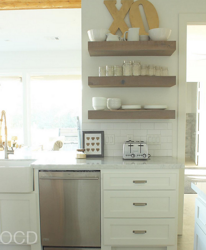 Floating Shelves. Kitchen Floating Shelves. Farmhouse Floating Shelves. The floating shelves are custom made from White Oak with a Classic Grey stain to give it a weathered look. Floating Shelves. Floating Shelves #FloatingShelves #KitchenFloatingShelves #FarmhouseFloatingShelves Beautiful Homes of Instagram @organizecleandecorate