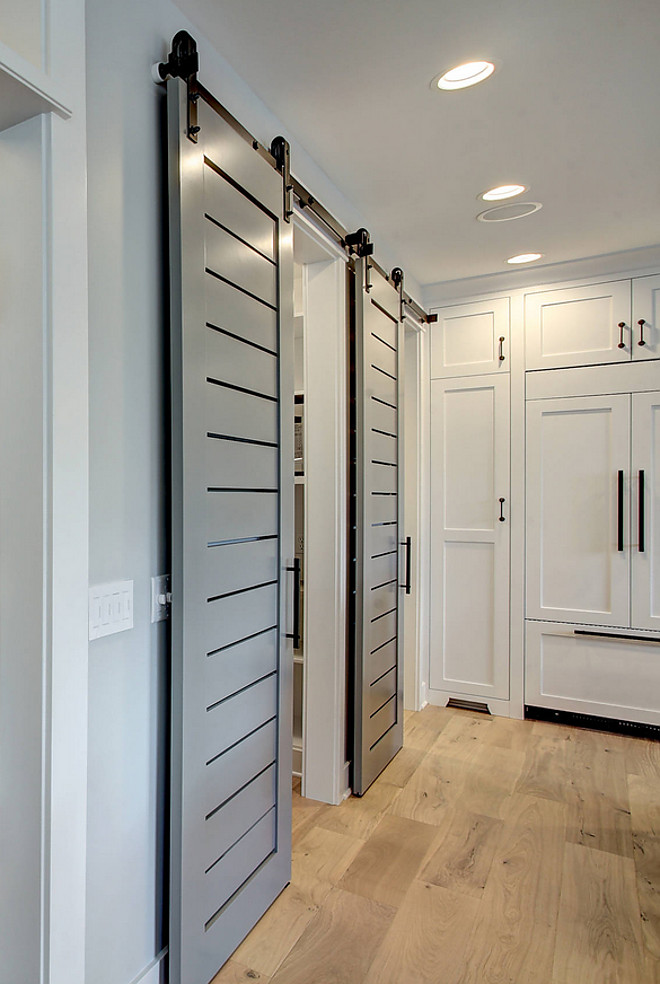Kitchen Barn Door. Barn Door. Grey barn door. Grey barn door paint color is Sherwin Williams Classic French Gray. The sliding barn doors were custom. #KitchenBarnDoor #BarnDoor #Greybarndoor #barndoorpaintcolor #SherwinWilliamsClassicFrenchGray CVI Design
