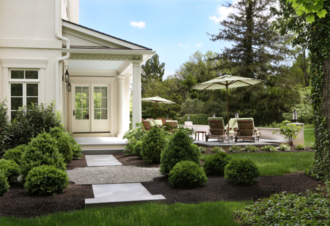 Landscaping. Traditional landscaping. This backyard oasis features a deep covered porch with tuscan columns and beadboard ceilings. #landscaping #traditionallandscaping Knight Architects LLC