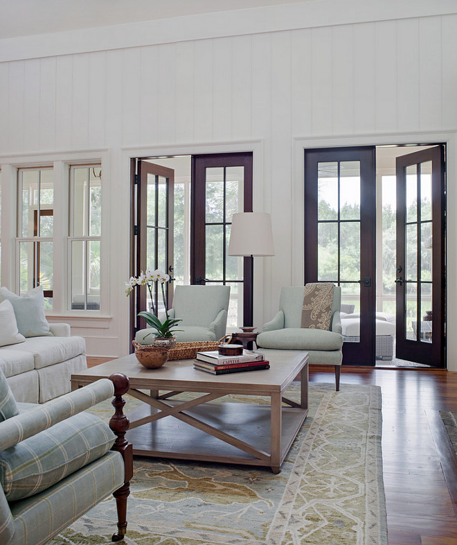 Living room French Doors. Southern-style living room with Mahogany French doors. Living room Mahogany French Doors. Living room French Door Ideas. Living room French Doors #LivingroomFrenchDoors #Livingroom #MahoganyFrenchDoors #Livingroom #FrenchDoorPearce Scott Architects