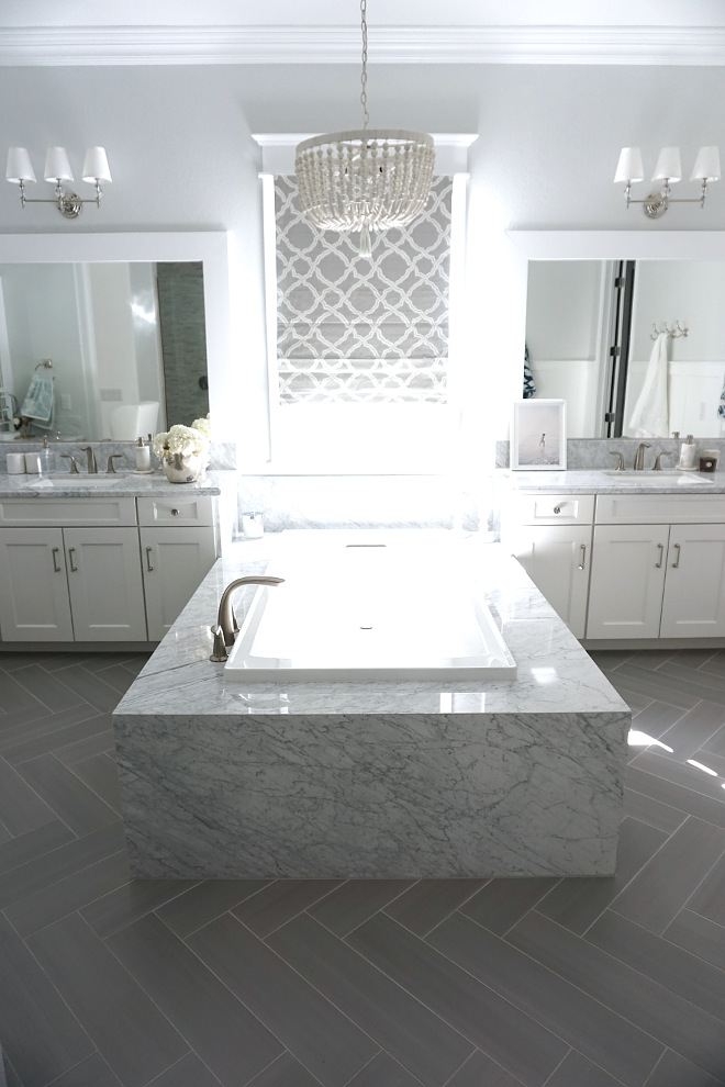 Marble Bathtub Surround. The bathtub is surrounded by polished carrara marble slabs. Marble Bathtub Surround. Marble Bathtub Surround. White Marble Bathtub Surround #MarbleBathtubSurround Beautiful Homes of Instagram @MyHouseOfFour