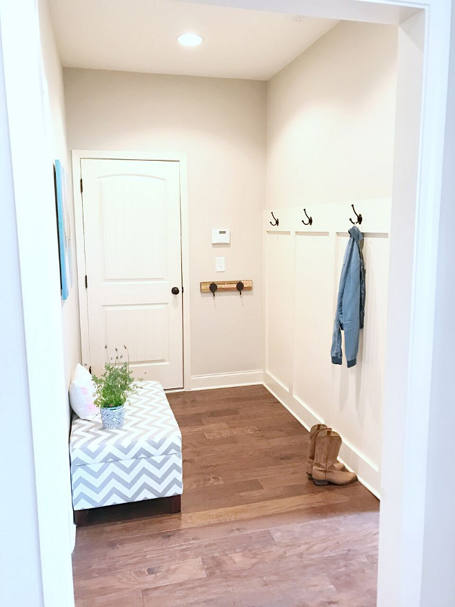 Mudroom. Mudroom: the laundry room is right off the mudroom and makes things very easy for sports days. Our pantry is also off of this room and that is where we keep our second refrigerator for easy access to extra water and drinks for the kids. Mudroom painting is by Lola Donoghue. Our kitchen has a desk area, that we use for homework. Desk area framed art is by Parima Studio #Mudroom Beautiful Homes of Instagram @sugarcolorinteriors