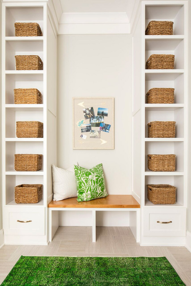 Mudroom Shelves. Mudroom with open shelves for baskets Mudroom Shelves. Wall color is Benjamin Moore Light Pewter 1464 and cabinets are Sherwin Williams SW 7004 Snowbound. Mudroom with open shelves for baskets #MudroomShelves #Mudroom #openshelves #baskets #mudroombaskets #BenjaminMooreLightPewter #BenjaminMooreLightPewter1464 Martha O'Hara Interiors