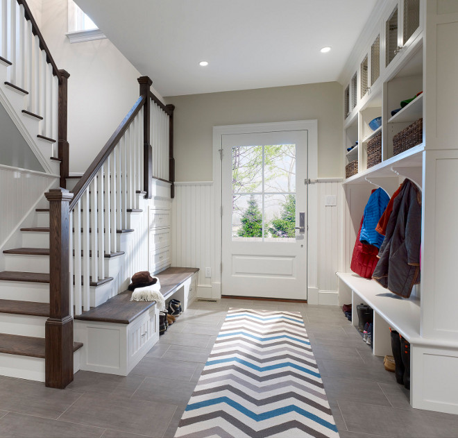 Mudroom Storage. Custom cabinetry and special storage bench built into the stairway make for an unusually efficient and beautiful mudroom #mudroom #mudroomstorage Knight Architects LLC
