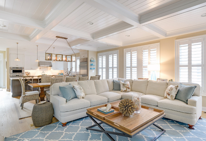 Open concept Coffered Ceiling. Area rug is by Surya and sectional is Sherrill Furniture. Open concept Coffered Ceiling Ideas. Open concept Kitchen Living Room Coffered Ceiling #Openconcept #CofferedCeiling #KitchenCofferedCeiling #LivingroomCofferedCeiling Echelon Custom Homes
