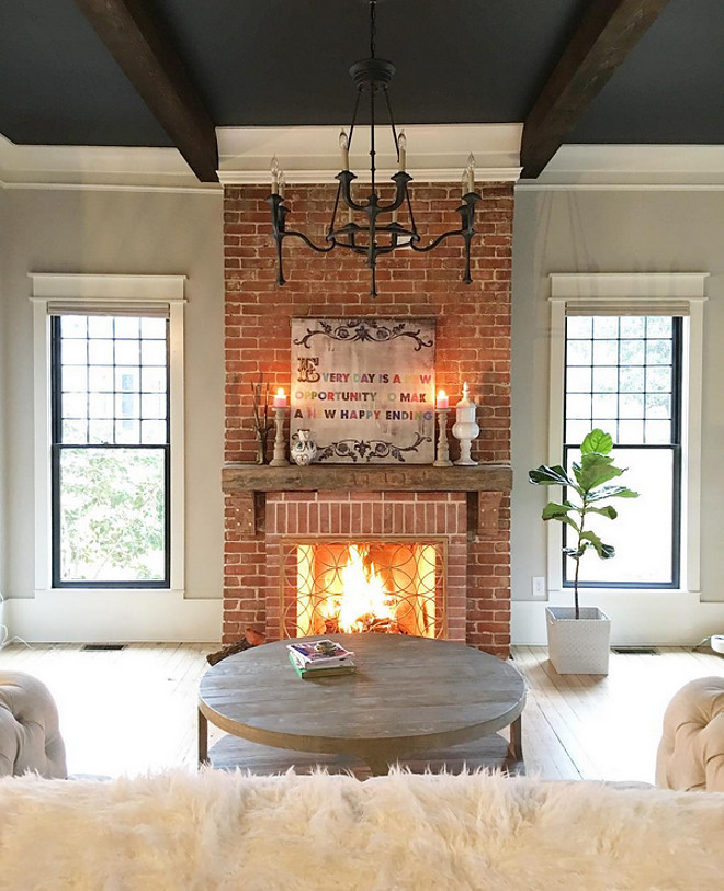 Reclaimed Brick Fireplace. This farmhouse features an original reclaimed brick fireplace. Chandelier: Currey & Company Conversation French Black Eight-Light Chandelier Reclaimed Brick Fireplace. Reclaimed Brick Fireplace. Reclaimed Brick Fireplace. Reclaimed Brick Fireplace #ReclaimedBrickFireplace