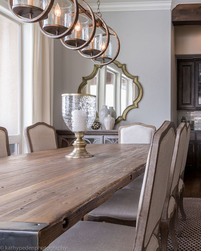 Rustic Farmhouse Table. Rustic wood and metal dining table is by Noir furniture and the upholstered chairs, in natural linen, are by Gabby Home. Rustic Farmhouse Table. Rustic Farmhouse Table. Rustic Farmhouse Table. Rustic Farmhouse Table #RusticTable #FarmhouseTable Restyle Design, LLC.