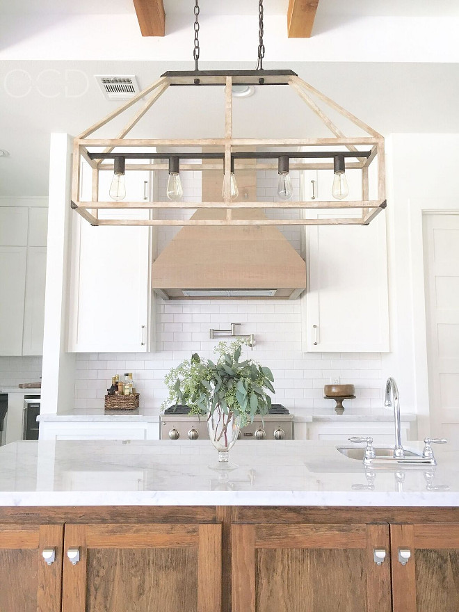 "Rustic Lighting. The rustic lighting is ""Fredrick Ramond FR41205IRR Emilie 5 Light 42 inch Iron Rust Linear Chandelier Ceiling Light"". Rustic Kitchen Lighting. The kitchen hood is White Oak with a Classic Grey stain. Rustic Linear Lighting. Farmhouse Kitchen Lighting. #RusticLighting #KitchenLighting #rustickitchenlighting #Rusticlinearlighting #linearlighting Beautiful Homes of Instagram @organizecleandecorate"