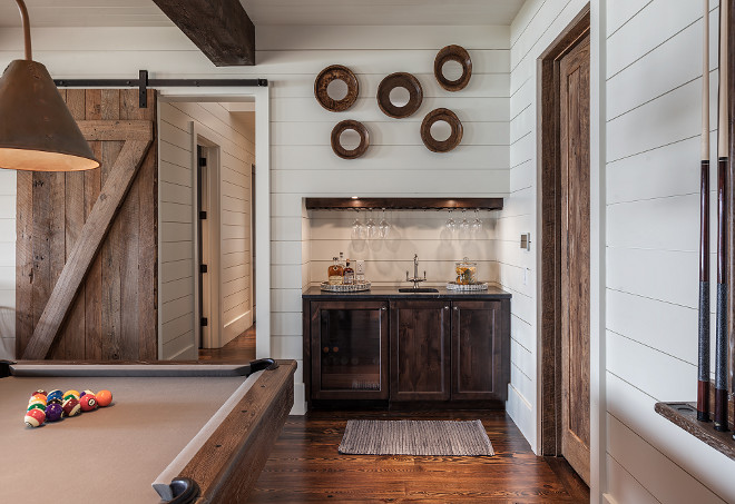 Shiplap Games Room. Games room with wet bar, shiplap walls, rustic barn door, heart pine floors. #Shiplap Games Room. Games room with wet bar, shiplap walls, rustic barn door, heart pine floors #Shiplap #GamesRoom #ShiplapGamesroom #wetbar #shiplapwalls #rusticbarndoor #barndoor #heartpinefloors Wright Design