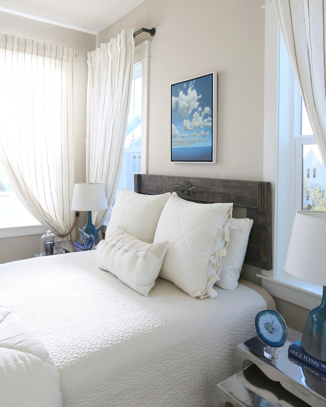 Small Bedroom. Small Bedroom Decor. The guest bedroom was designed for a soothing effect with greys, blues and white decor. The designer found the antique headboard (formally a footboard) at a local shop. Small Bedroom Bedding Ideas. Neutral Small Bedroom. #SmallBedroom #SmallBedrooms #SmallBedroomDecor # BeddingIdeas #NeutralSmallBedroom #NeutralBedroom #SmallBedroom JoAnn Regina Home