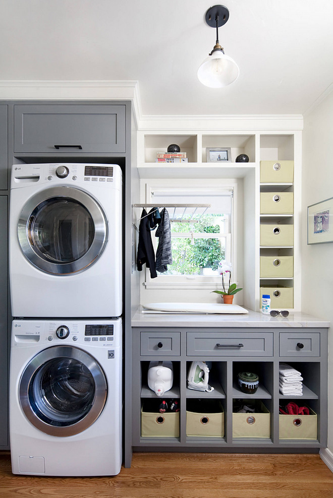 Small Laundry Room Space ideas. Stacked machines laundry room. Grey cabinet paint color is Sherwin Williams Cityscape #SmallLaundryRoom #LaundryRoom #SmallLaundryRoomSpace #SmallLaundryRoomSpaceideas #Stackedmachines #laundryrooms #Greycabinet #paintcolor #SherwinWilliamsCityscape Jessica Risko Smith Interior Design