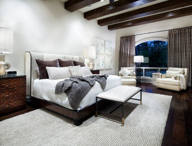 Transitional Bedroom with wood beams. Transitional Bedroom with wood ceiling beams and dark hardwood floors #TransitionalBedroom #bedroom #woodbeams JAUREGUI Architecture Interiors Construction