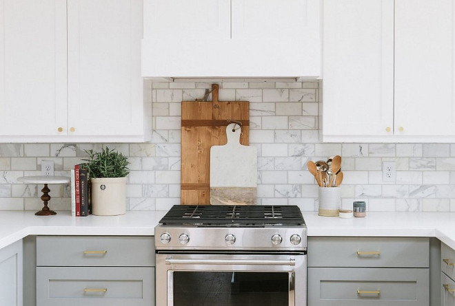 Two toned White and grey kitchen. Two toned kitchen with white upper cabinets and grey lower cabinets. Two toned White and grey kitchen. Two toned kitchen with white upper cabinets and grey lower cabinets and brass hardware #Twotonedkitchen #towtonedWhiteandgreykitchen #Whiteandgreykitchen #whiteuppercabinets #greylowercabinets Studio McGee