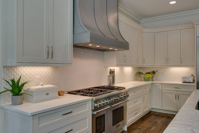 White kitchen with mini tile backsplash and curved metal hood. White kitchen with mini tile backsplash and curved metal hood #Whitekitchen #minitilebacksplash #backsplash #curvedmetalhood #metalhood Tammy Coulter Design - Grandfather Homes