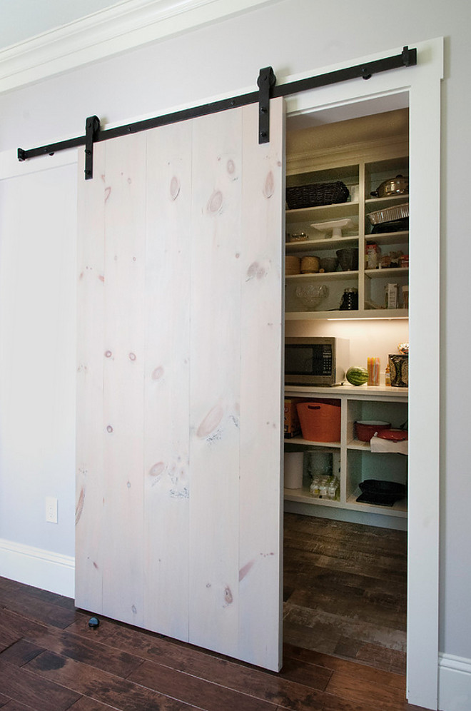 Whitewash barn door. Simple Whitewash barn door. Barn doors have been seen in many Fixer Upper episodes and I specifically like this one, designed by Gulfshore Design. Simple whitewashed pine planks makes a great barn door! Whitewash pine barn door #Whitewashbarndoor #Whitewash #barndoor #simplebarndoorideas #Whitewashpine #pinebarndoor #pinedoor Gulfshore Design