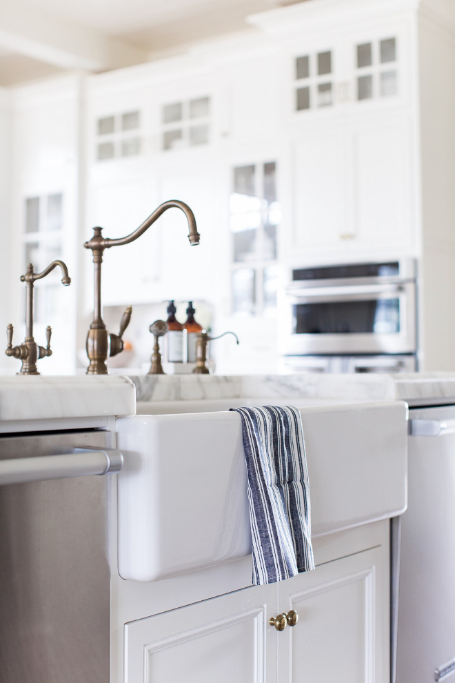 Aged Brass Kitchen Faucet. Unlacquered brass faucet. A farmhouse sink with aged brass faucet is flanked by two stainless steel dishwashers. Brass Faucet. Aged Brass Kitchen Faucet and farmhouse sink. Aged Brass Kitchen Faucet #AgedBrassKitchenFaucet #KitchenFaucet #brassfaucet #Faucet #AgedBrassFaucet #farmhousesink Pink Peonies Rachel Parcell's Kitchen Pink Peonies Rachel Parcell's Kitchen