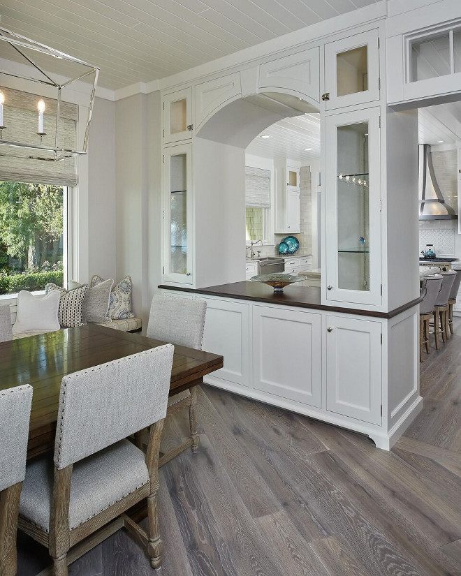 "Arched Cabinet separates kitchen from Dining area. A cabinet with a ""pass-trough"" arch separates the kitchen from the dining area. Kitchen Cabinet Ideas. Kitchen Dining room layout. Arched Cabinet separates kitchen from Dining area. #ArchedCabinet #kitchen #Diningarea #KitchenCabinetIdeas #KitchenDiningroom #KitchenDiningroomlayout #ArchedCabinet Regina Andrew Clear Glass Pendant Light"