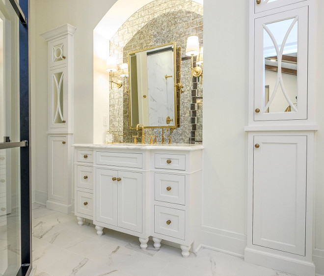 Bathroom Cabinet tucked into an arched niche and two cabinet towers on both sides. The other side of the bathroom features another cabinet tucked onto an arched niche anchored by two cabinet towers with mirrored doors. Bathroom Cabinet tucked into an arched niche and two cabinet towers on both sides. #BathroomCabinet #Cabinetniche #Bathroom #Cabinet #Bathroomniche #niche #archedniche #cabinets Ramage Company